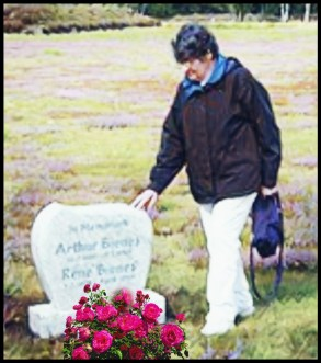 Marion Bienes at her parents gravestone.