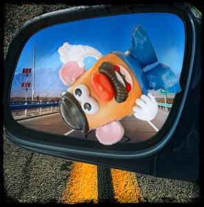 Mr Potato Head in rear view mirror