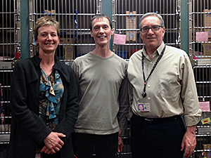 Ann Potter of the Apartment Cat Team and Mike Phillips of the New York City Feral Cat Initiative with Mike Oswald (right) on a visit to Multnomah County Animal Services. (Photo by Valerie Sicignano.)