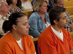 Valbona Lucaj and Sebastiano Quagliata on trial (foreground, in orange.) (Lapeer County Court photo)