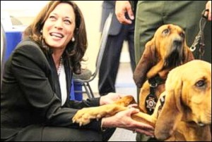 Kamala Harris with bloodhound dogs