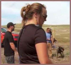 Ashley Nicole Welch appeared to be the only security guard/dog handler wearing a shoulder microphone. (From Facebook video.)