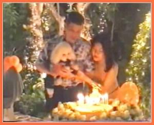 Crown Prince Vajiralongkorn and the Crown Prince's third wife, Princess Srirasm, feeding birthday cake to Fufu the poodle.