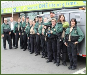 Don Jordan (in suit, rear left) with Seattle Animal Shelter staff. (Seattle Animal Shelter photo)