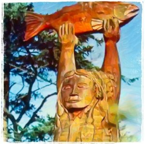Sculpture of Indigenous man with salmon