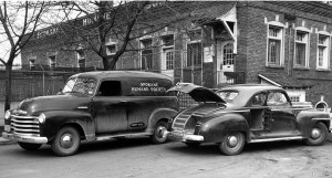"The state-of-the-art Spokane Humane Society motor pool in 1949. The sedan in front, used for emergency animal pick-ups, featured an on-board ""lethal chamber,"" opened for display."