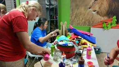 Big Cat Rescue volunteers prepare behavioral enrichment toys for the cats. (Beth Clifton photo)