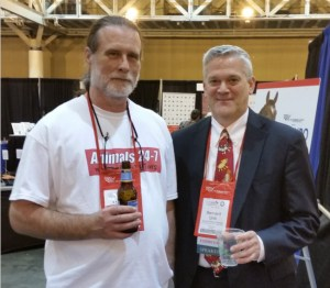 ANIMALS 24-7 editor Merritt Clifton enjoys a beer with HSUS senior advisor Bernard Unti at HSUS Expo 2015 in New Orleans. (Beth Clifton photo)