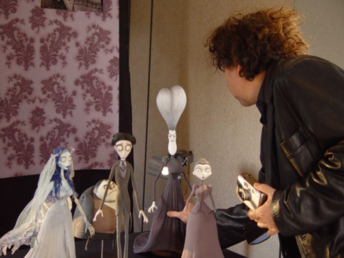 Man adjusting puppets for Corpse Bride