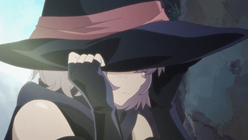 A girl hides beneath a witch's hat
