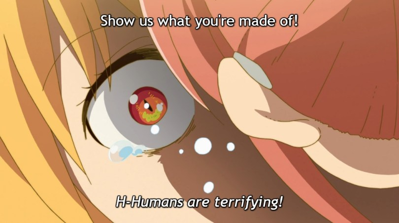 """Close-up of Tohru's terrified and tearful eye as Kobayashi shouts """"Show us what you're made of!"""" at her. Subtitle: """"H-Humans are terrifying!"""""""