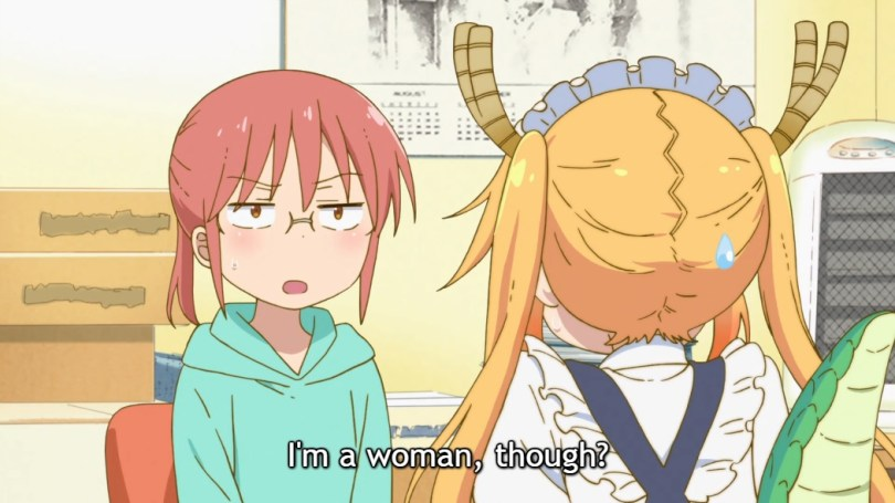 """Miss Kobayashi, wearing glasses and a hoodie and looking unimpressed, speaks to Tohru, a feminine young woman in a maid's costume with dragon horns and a tail. Subtitle: """"I'm a woman, though?"""""""