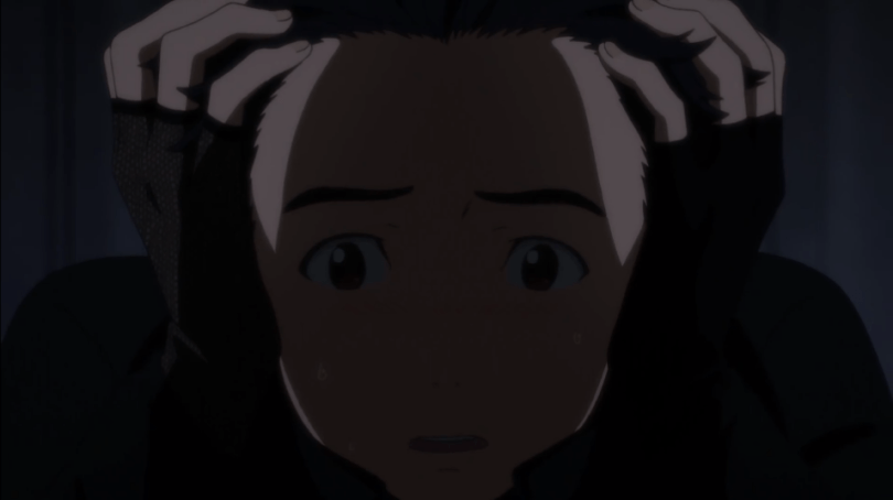 Close-up of Yuri Katsuki from Yuri!!! on ICE looking panicked as he fights his anxiety before a skating competition performance.