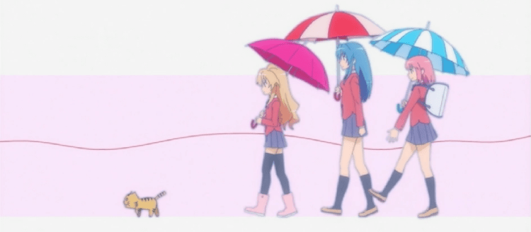 A short blonde girl, a tall blue-haired girl, and a bouncy redhead, all in school uniforms, hold umbrellas and walk in a line, following a cat