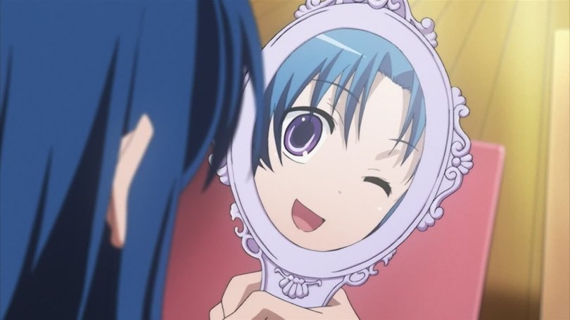 A blue-haired girl winking at her own reflection in a round handheld mirror