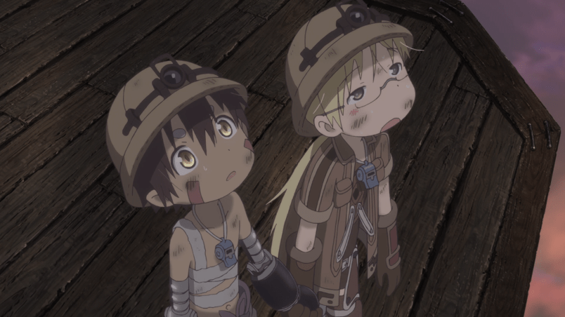 A girl with long blonde hair wearing hiking gear a boy with short brown hair with his midriff wrapped in bandages stand on a platform, looking up. They are holding hands. Both are wearing explorers' helmets and are scuffed with dirt stains. The boy looks curious; the girl exhausted.