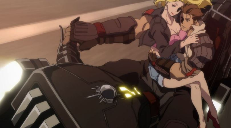 A man riding a motorcycle with the blonde woman on his lap. his arm is almost as big as the bike.