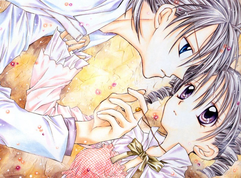 A close-up of a teen boy and girl, apparently lying down next to each other. The boy has one finger looped around the girl's necklace and is leaning towards her; the girl has one hand reaching out and brushing the collar of his shirt. Both look quietly sad.