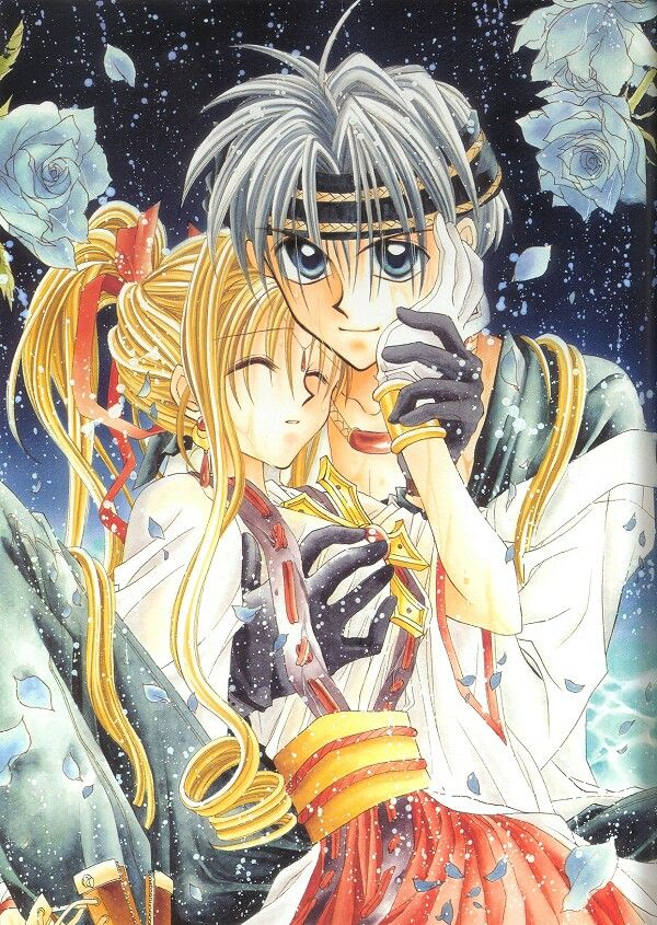 A teen boy wearing a headband and medieval fantasy clothing holds a teen girl in his arms and presses one of her hands to his cheek. The girl has long hair pulled back in a ponytailand is wearing fantastical clothes inspired by traditional Japanese dress. There are white-blue roses framing them, and a dark background that looks like a starry sky.