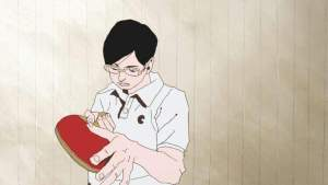 A rotoscope-style young man examining a ping pong paddle