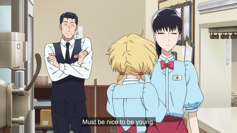 "Kondo in his work uniform looks at Akira and a blonde coworker, both in their restaurant uniforms. He thinks ""Must be nice to be young."""
