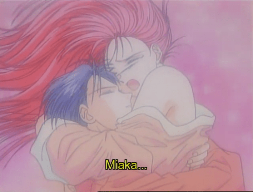 "A pastel image of a teen girl (Miaka), her shoulders bare, as she throws her arm around a teen boy (Taka) and sobs. Subtitles: ""Miaka..."""