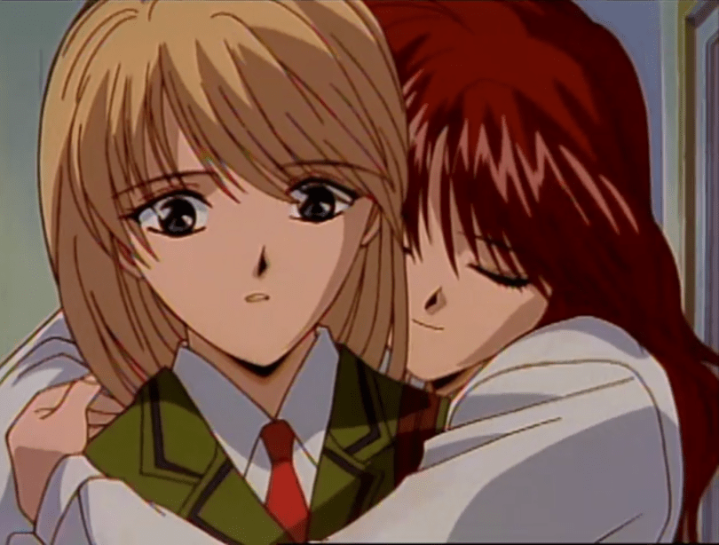 A teen girl with long brown hair (Miaka) hugs another teen girl wearing a school uniform (Yui) from behind, who looks surprised.