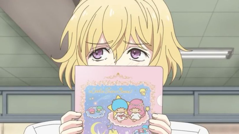 Ryo from Sanrio Boys holding a book in front of his face and looking embarrassed