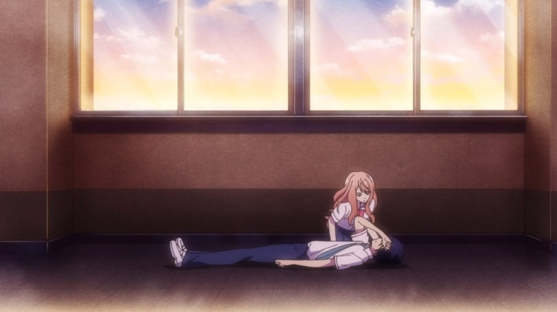In a school hallway at sunset, a teen girl in a school uniform leans over a teen boy in a school uniform, who's lying on the ground with a hand over his eyes.