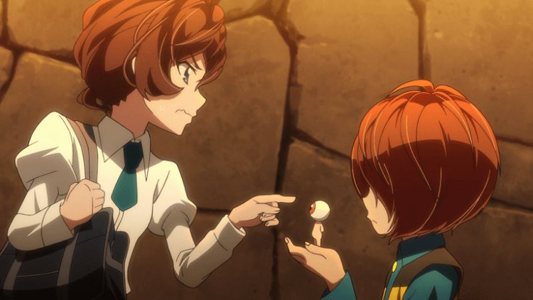 A girl in school uniform points at a tiny naked figure with an eyeball for a head, which is being held in the hands of a short young boy with shaggy hair. She looks aggressively skeptical.