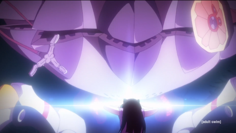 Light coming from Hidomi's forehead as a robot comes toward her