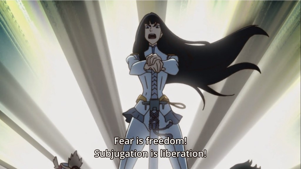 Satsuki posing atop the school. caption: Fear is freedom! Subjugation is liberation!