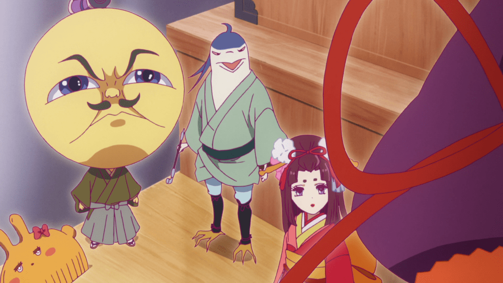"""A screenshot from """"We Rent Tsukumogami."""" A comb shaped like a rabbit, a person with a large moon-like face, a bird-like creature dressed in traditional Japanese robes, and a young woman in a kimono all look up expectantly at a batlike figure in the foreground, with his back to the camera."""