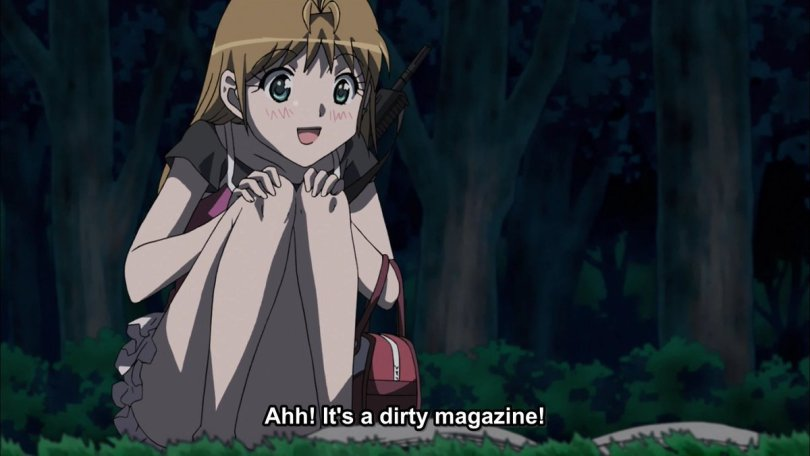 Yamada crouched down in the woods in front of a battered magazine. subtitle: Aah! It's a dirty magazine!