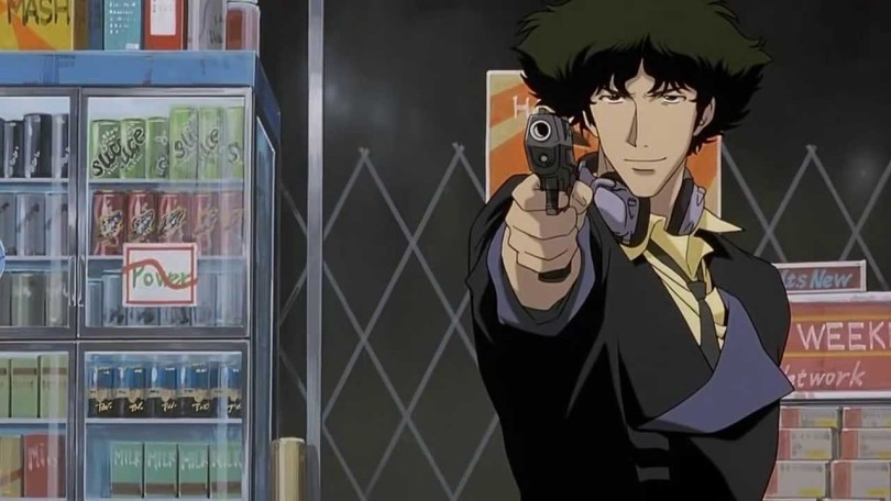 Spike Spiegel standing in front of a convenience store, smiling slightly as he points a gun