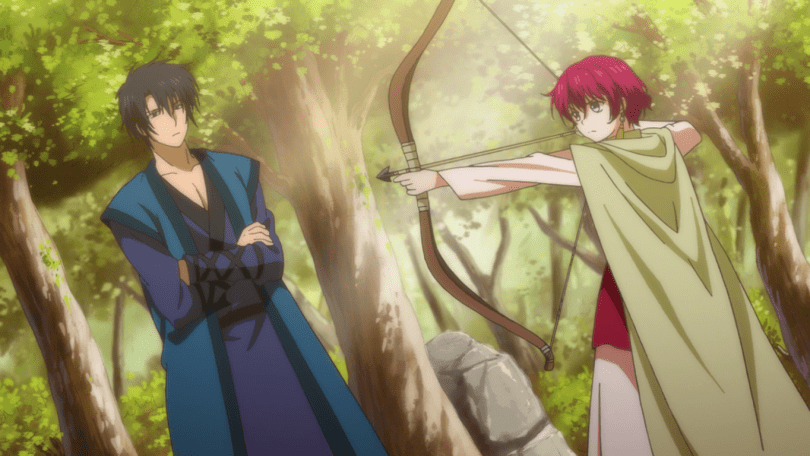 A redheaded young woman points a bow and arrow while a young man in dark clothes watches her.