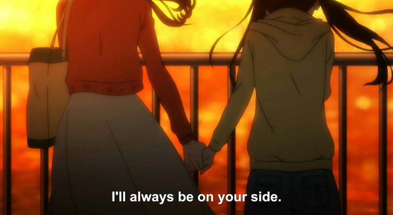 "Two girls hold hands as they stand in front of a railing, the sun setting in front of them. Subtitles read ""I'll always be on your side."""