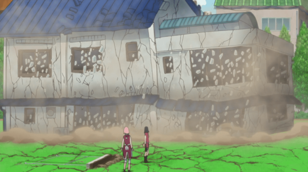 Sakura and another female ninja stand in front of a collapsing building