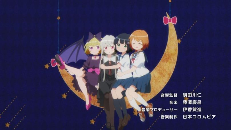 four girls sitting on a paper crescent moon