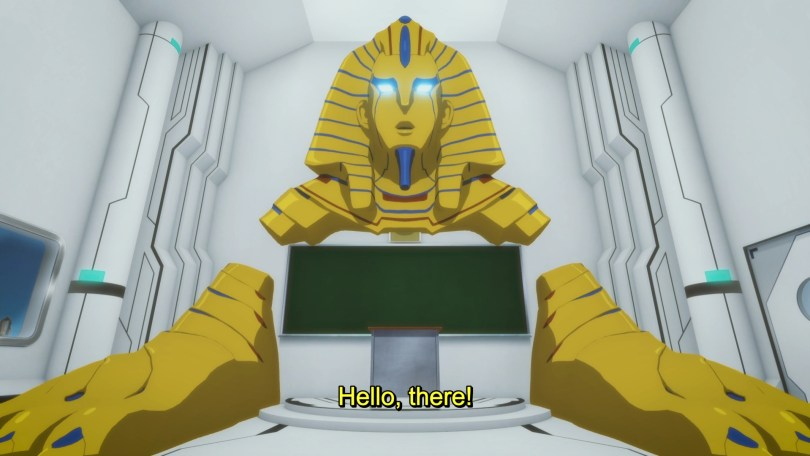 """A big golden Egyptian sphinx protudes from a classroom wall in a 3D rendered classroom. He says: """"Hello, there!"""""""