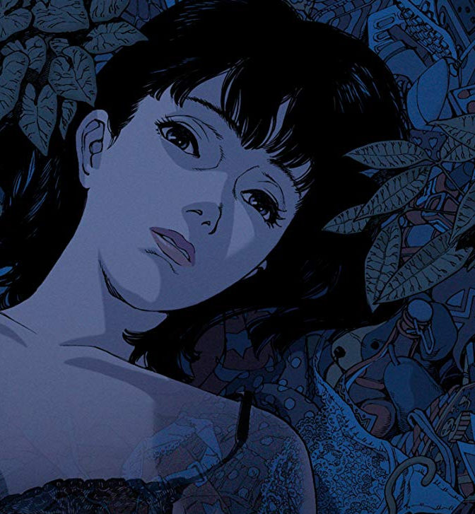 a blue image of a woman in only a bra staring at the camera, lying on a bed of fish and leaves