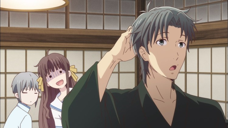 Shigure scratches his head while looking away from Tohru and Yuki. Tohru looks puzzled.