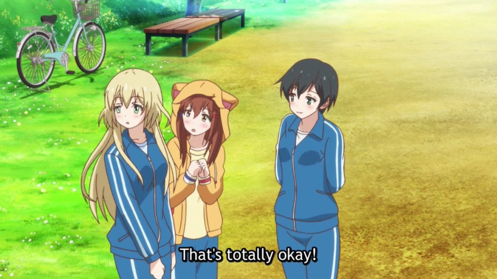 "Three teen girls on the edge of a baseball field. Two girls are in sweatsuits while another is wearing an animal hoodie. Subtitles read ""That's totally okay!"""