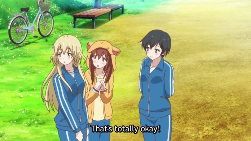 "Teen girls wearing sweatsuits stand on the edge of a baseball field. One girl is wearing a cat-eared hoodie. Subtitles read ""That's totally okay!"""