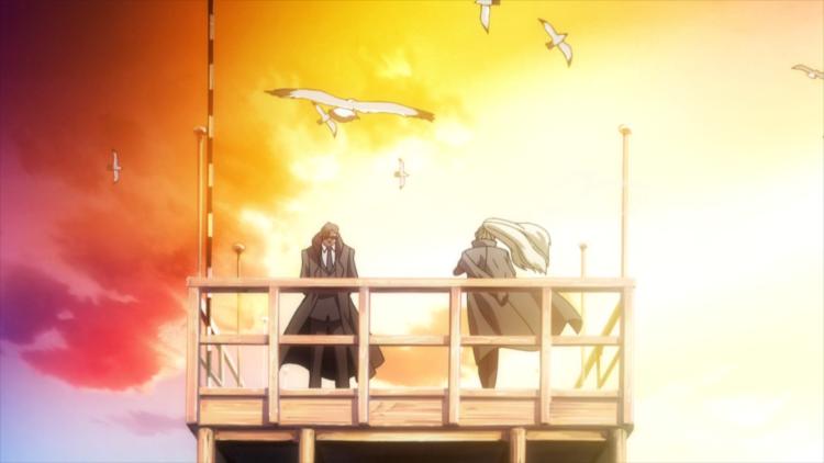 Chang and Balalika on a dock at sunset