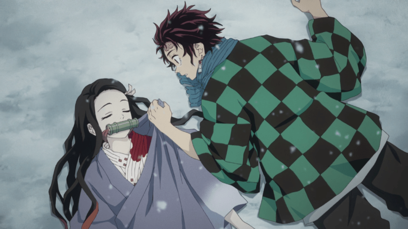 Nezuko and Tanjiro lie on the ground side by side in the snow
