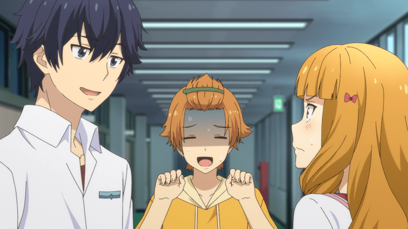 A teen boy with his hair pulled back in a half-ponytail stands nervously between another teen boy and a girl with long hair, who are glaring each other