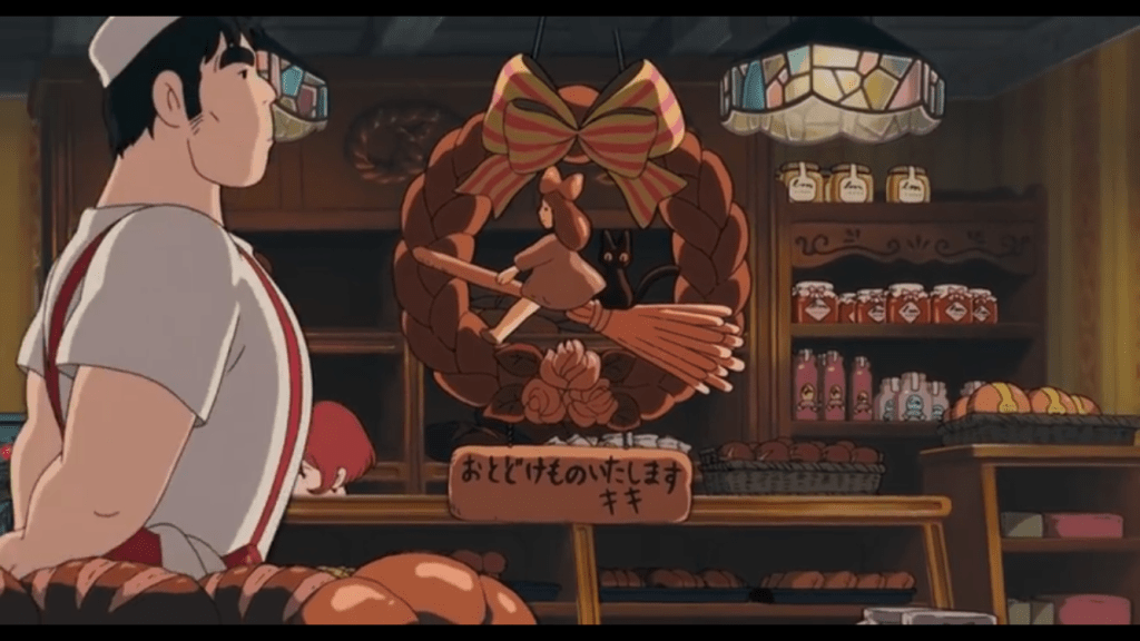 A window display at the bakery advertising Kiki's delivery service in bread form