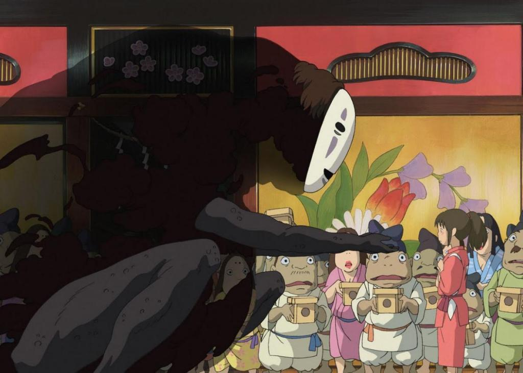 Chihiro in her bathhouse uniform faces a towering No-Face, who holds out a hand as if offering something to her. A crowd of yokai attendants are in the background.
