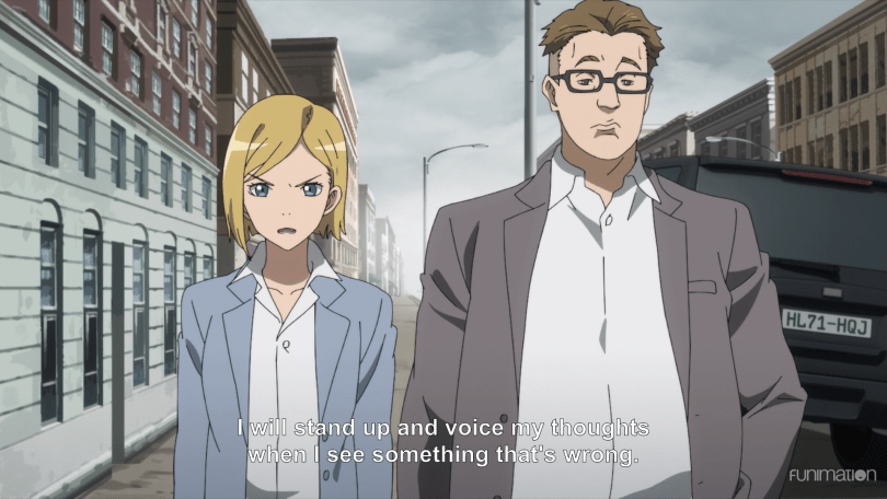 Sonia on the street next to her unimpressed superior. subtitle: I will stand up and voice my thoughts when I see something that's wrong.